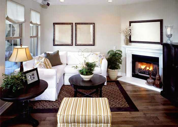 decorating small living room with corner fireplace white sofa
