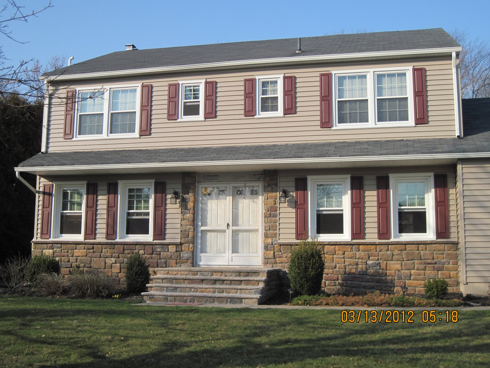 Benchmark Siding Co Llc Cultured Stone Enhances The