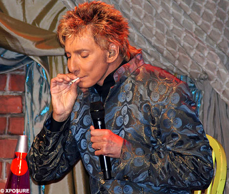 Either Barry Manilow is experimenting with marijuana again, or the facelift ...
