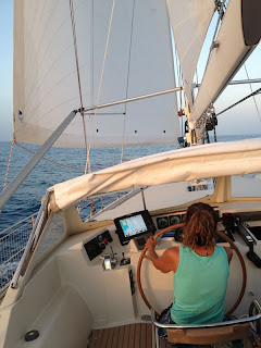 Diane at the helm (Note the elaborate whisker pole setup)