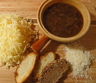 Crock of French Onion Soup with Sliced Bread and Grated Cheeses