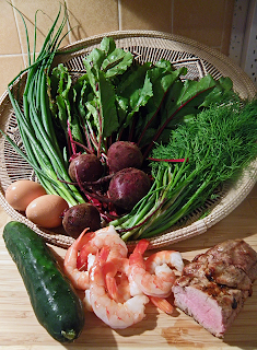 Basket of Beets with Greens, Cucumber, Green Onion, Dill, Eggs, Cooked Shrimp, and Roasted Pork