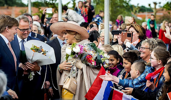 King Willem-Alexander and Queen Maxima visit during an region visit Zeeuws Vlaanderen