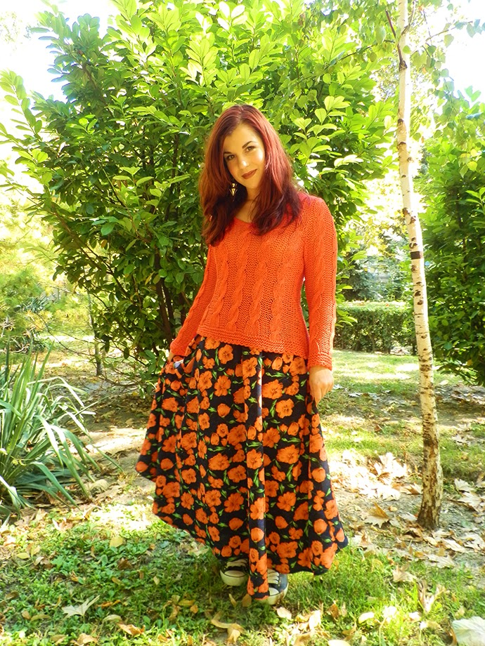Casual Autumn outfit featuring hand knitted orange sweater, handmade floral maxi skirt, leather studded sneakers, yellow tights and golden earrings