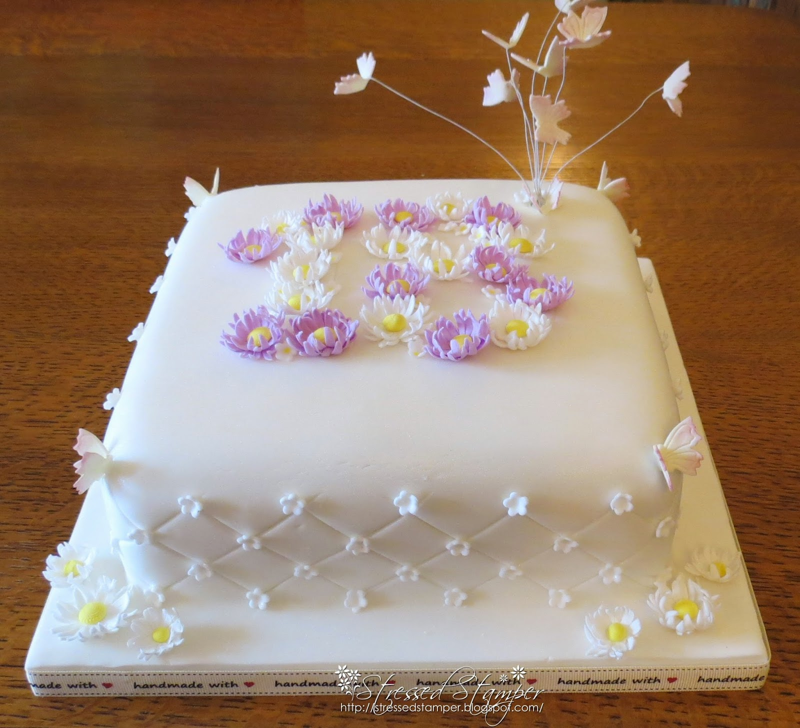 Emilys 18th birthday cake and this was emilys 18th cake i made for new years event believe she is 18 so this is her cake flowers and butterflys as always made out of izmirmasajfo