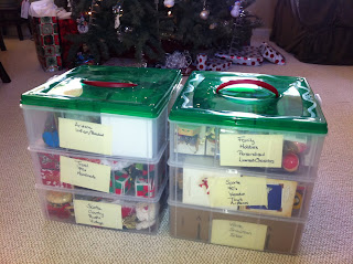 Christmas ornaments organized by theme in layers in plastic Snapware Stack-N-Store ornament container boxes