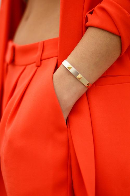 Bright orange jacket, pant and bracelet