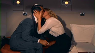 Grant and Saint kissing North by Northwest 1959 movieloversreviews.blogspot.com