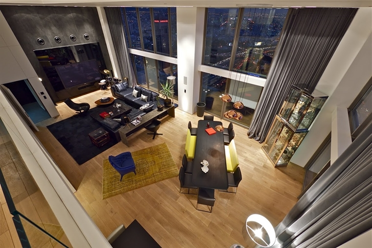 First floor as seen from the upper floor in Triplex penthouse apartment by Pitsou Kedem