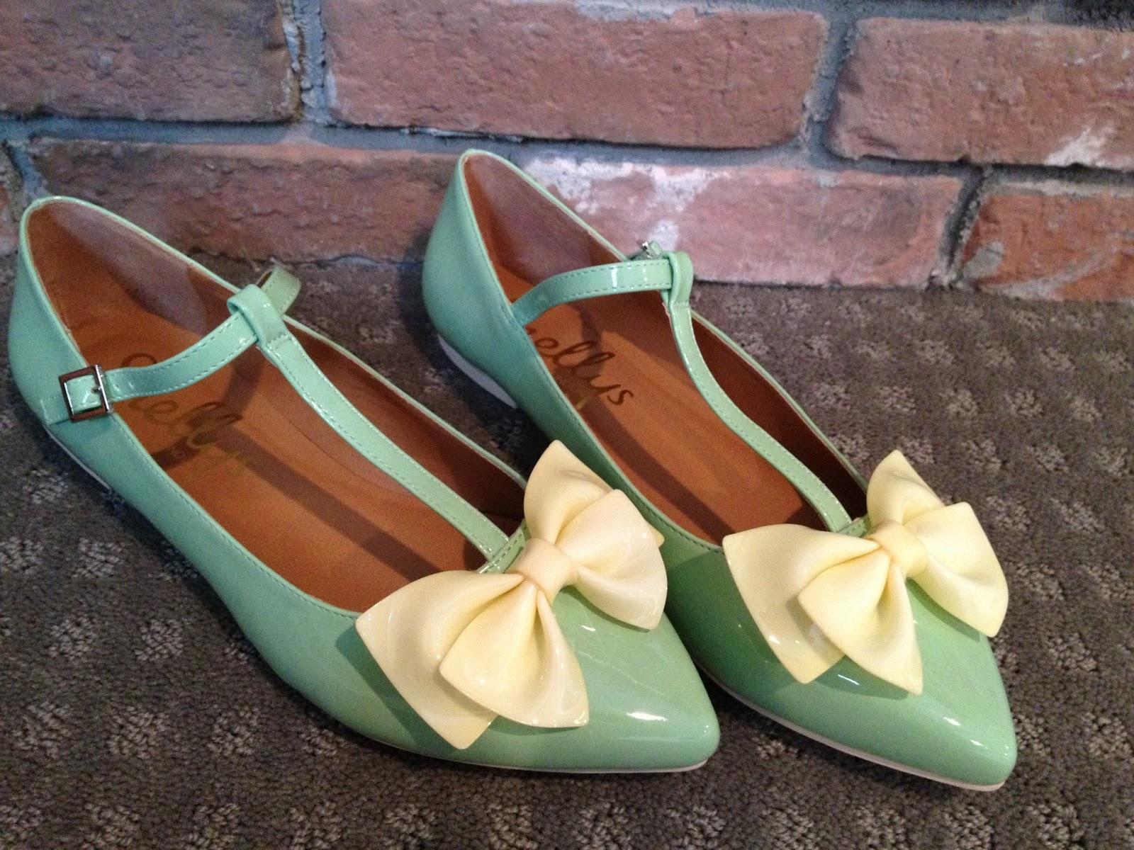 bow shoes, european shoes, yellow bows, seafoam green shoes, shoes, designer shoes, brick wall, brick, yellow, green, tstrap, t strap shoes