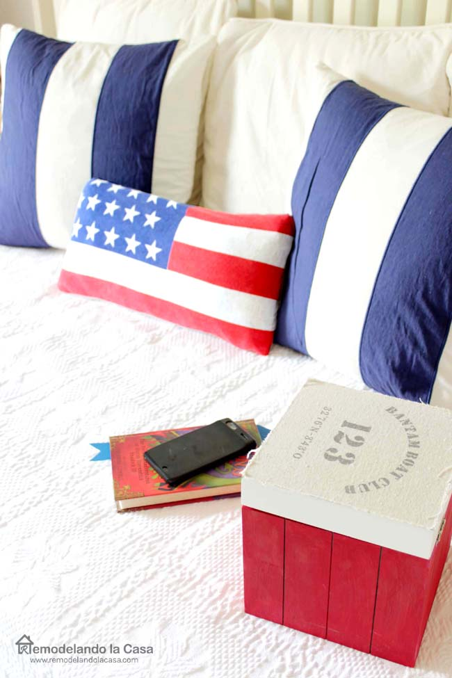 red white and blue pillows on bed