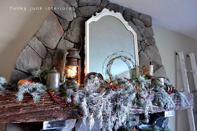 Junk inspired Christmas fireplace mantel decorating via Funky Junk Interiors