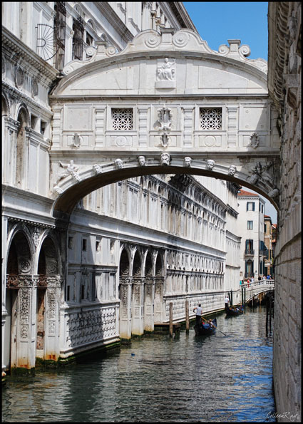 Bridge of Sighs with gondoliers floating by, Venice