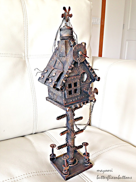 http://butterfliesnbuttons.blogspot.ie/2015/07/altered-bird-house-steampunk.html
