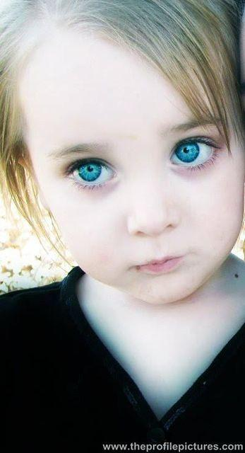 Cute Little Girl With Blue Eyes