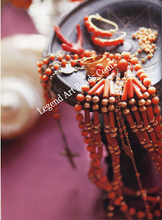 Rosary beads and earrings dating from the end of the nineteenth century. The ring is a contemporary Italian creation. The gold and coral bead, four strand necklace comes from Palestine, where It was worn by bedouin women.