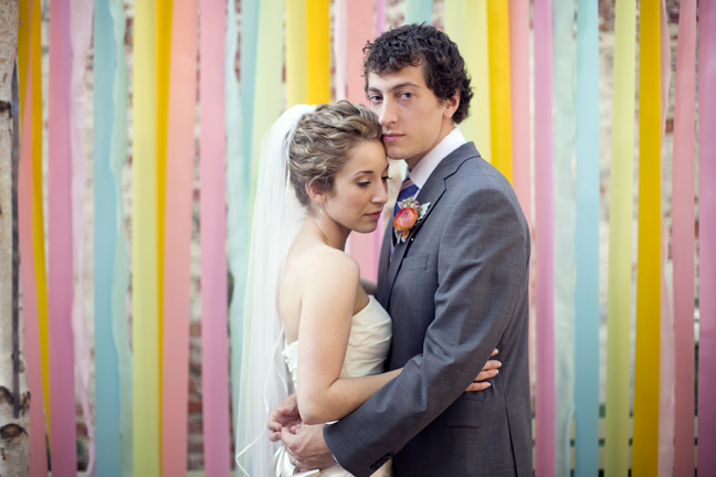 Zingerman's on fourth 4th wedding ann arbor kerrytown wedding sweet pea floral design ribbon backdrop curtain rainbow