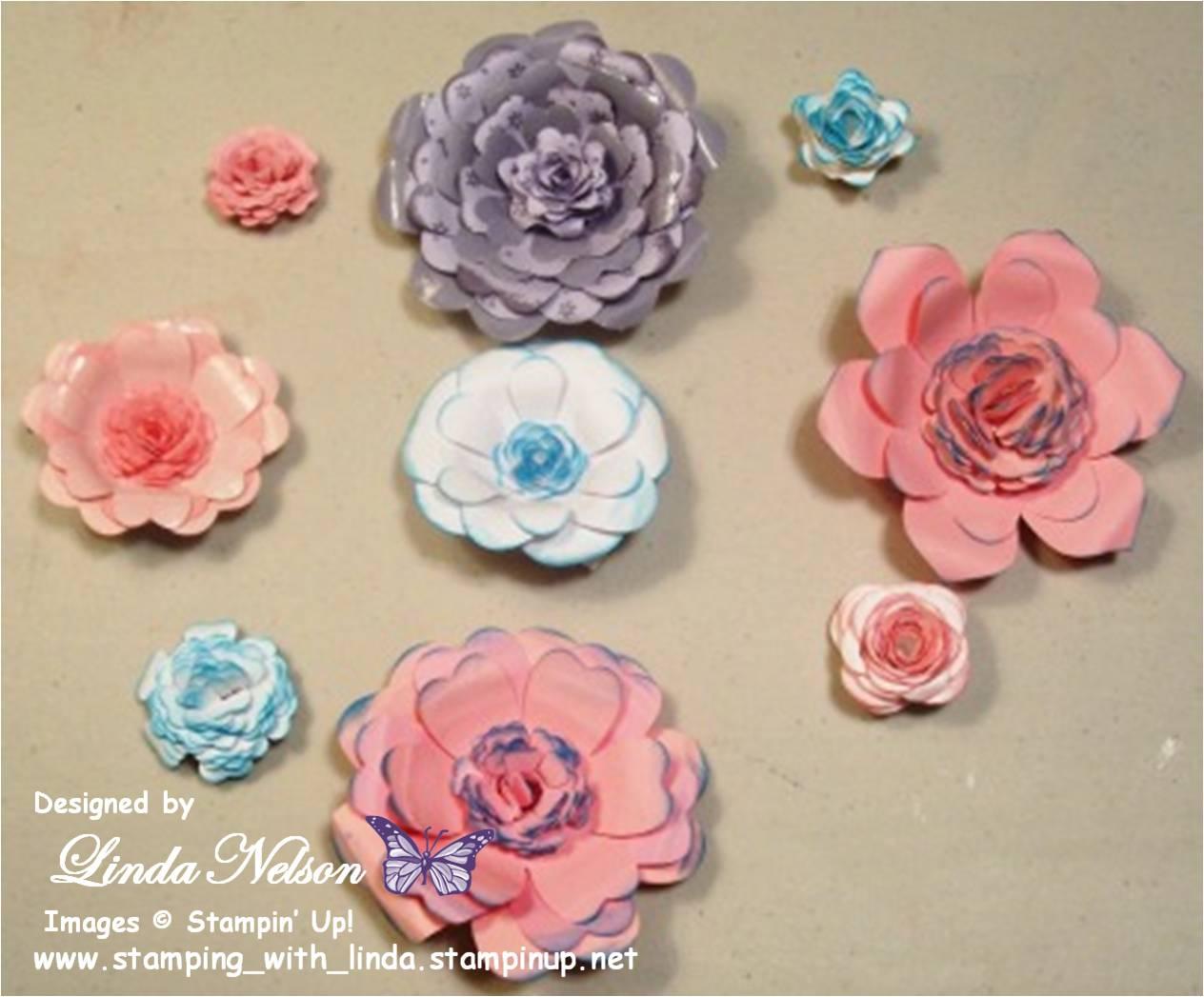 http://4.bp.blogspot.com/-4vxCcTxE6io/UVkaUdOQ-iI/AAAAAAAABys/TH1TEkz9aHY/s1600/Cricut+Paper+Flowers+with+wim.jpg