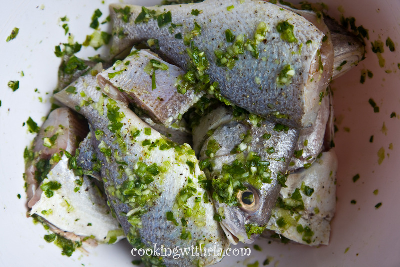Bring water to boil in a large pot with a cover over high for Trinidad fish broth