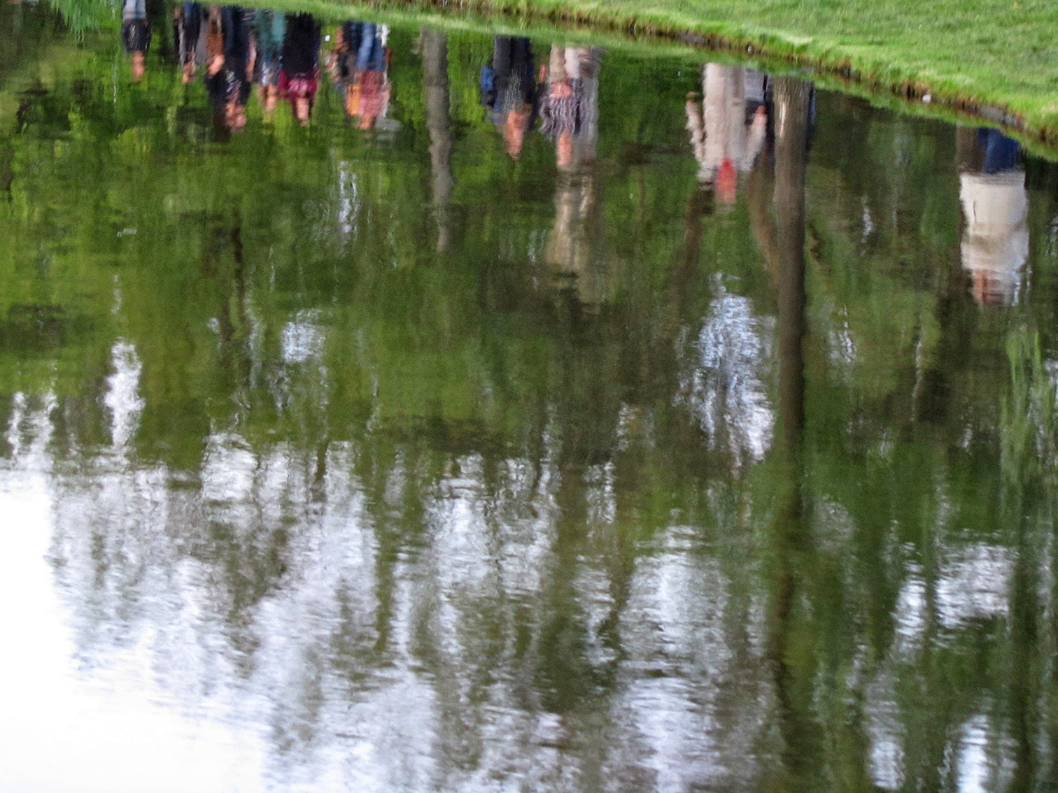 reflection of people in a pond