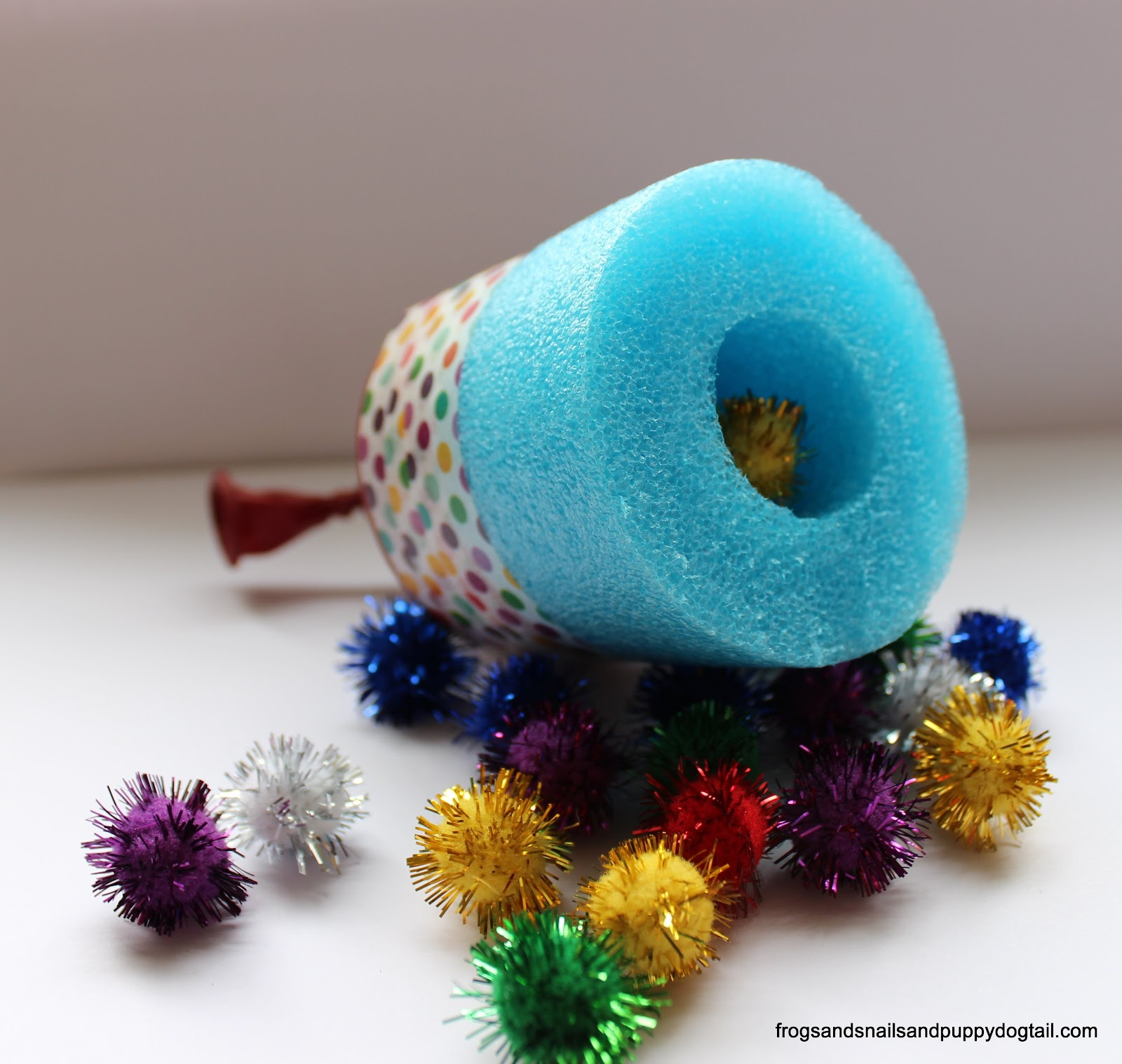 DIY pool noodle shooter with pom poms
