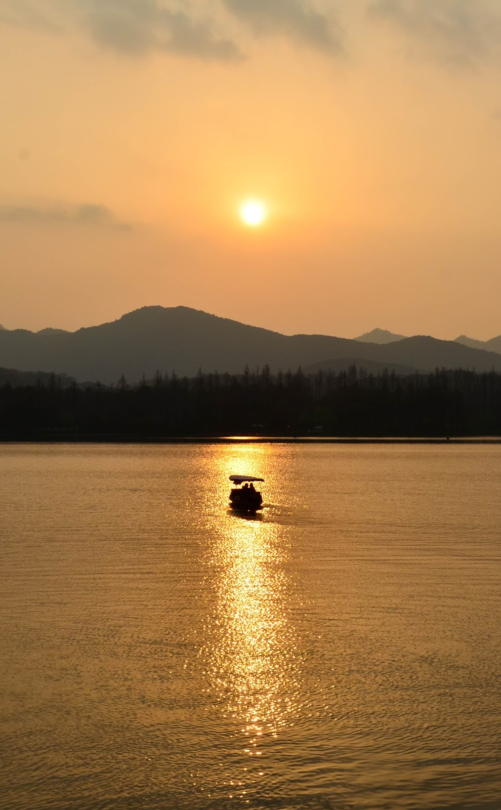 gorgeous sunset by the lake in hangzhou