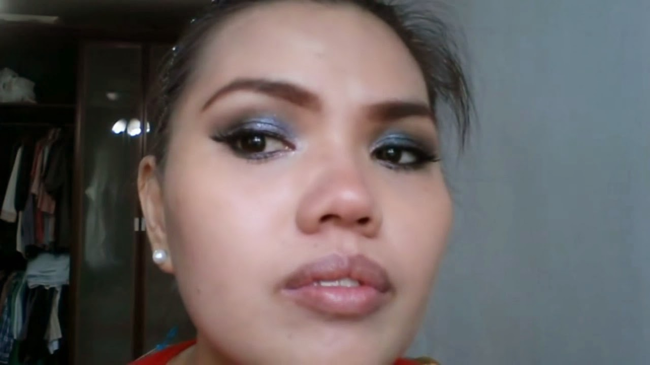 Black Smokey Eyes Makeup Tutorial. Lady showing her makeup