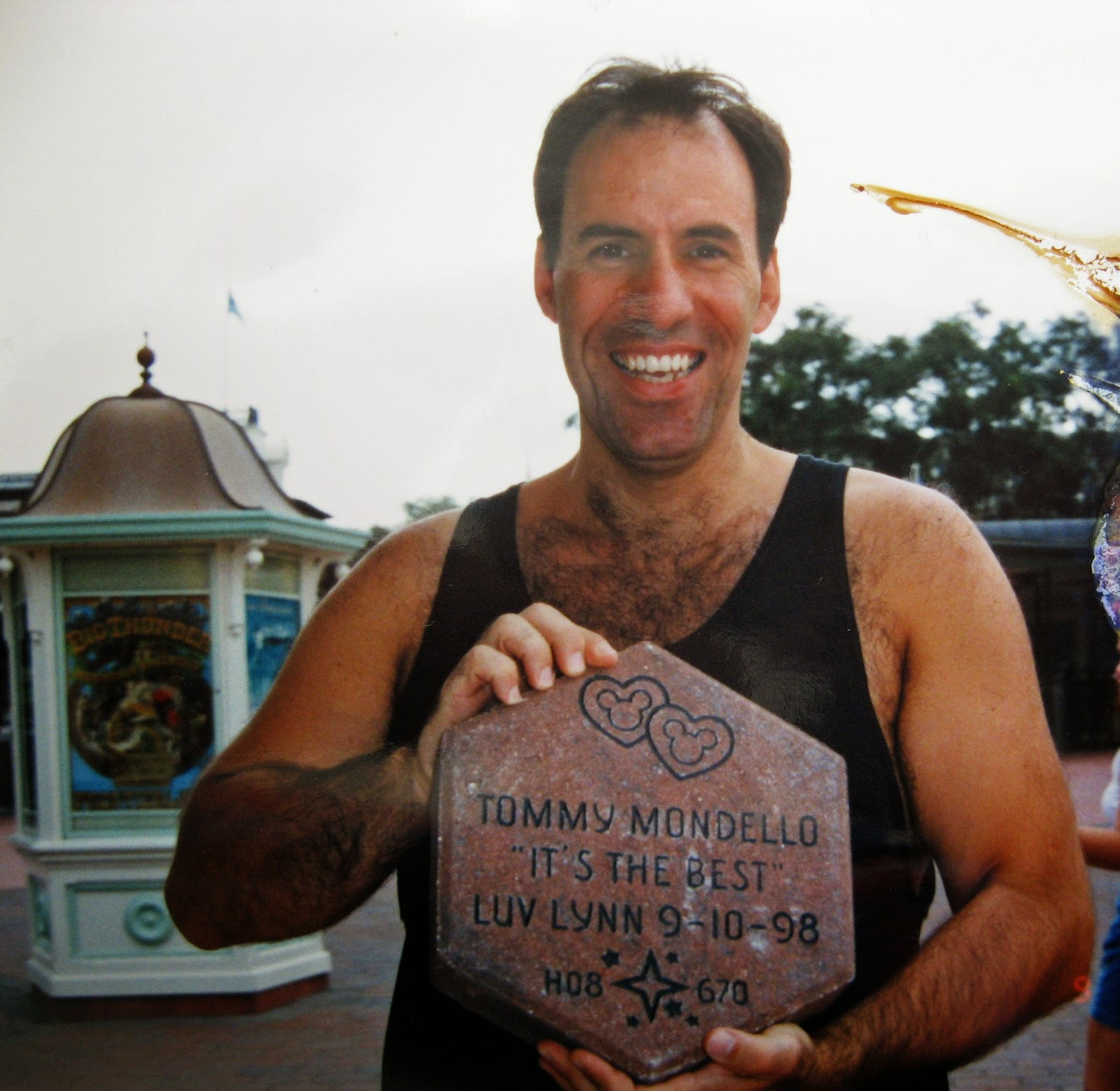 Tommy Mondello holding his Disney brick