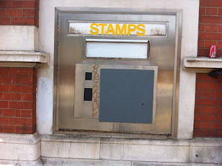 Disused stamp vending machine, West Kensington