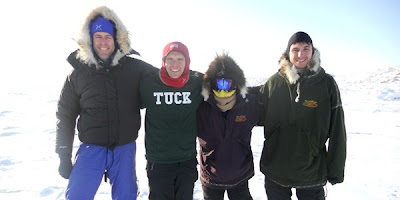 Four team members of Polar Vision dressed in ski parkas