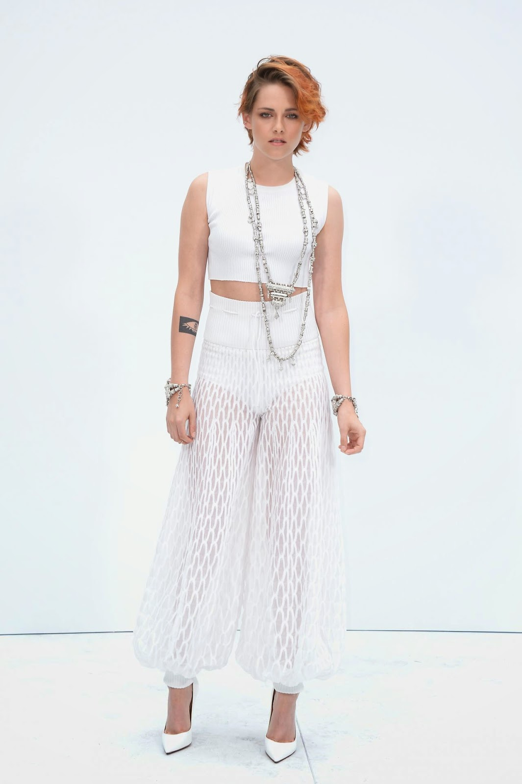 Kristen stewart debuts short cropped copper hair at the for American haute couture