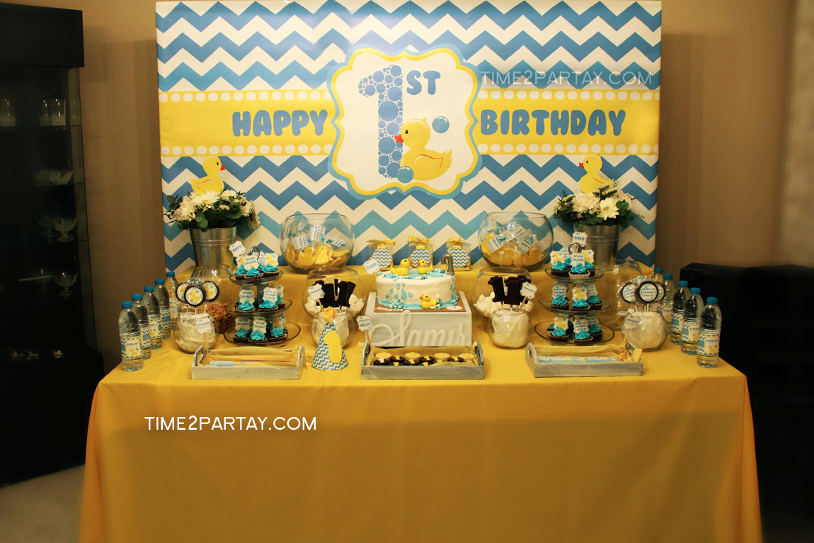 The Dessert Table. We Designed A Modern Background And Added A Cute And  Classic Rubber Ducky To It. The Water Bottles And Chocolate Lollipops Were  Wrapped ...
