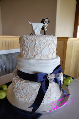 Intricate white and navy wedding cake