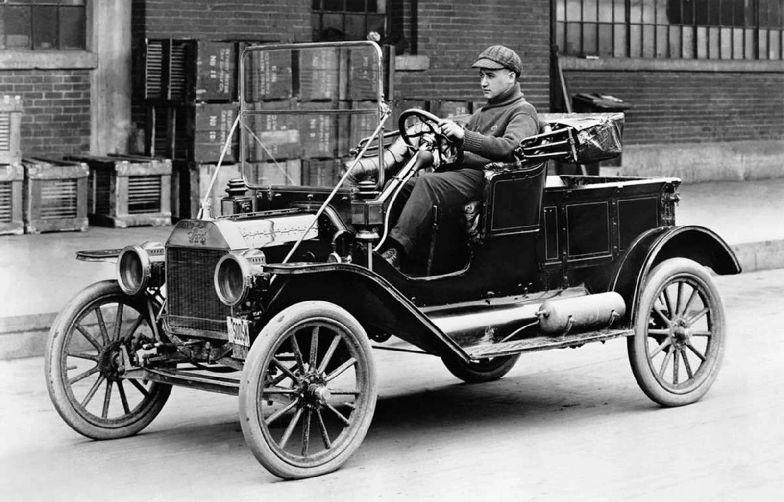 Man with his prized Model T Ford roadster ~