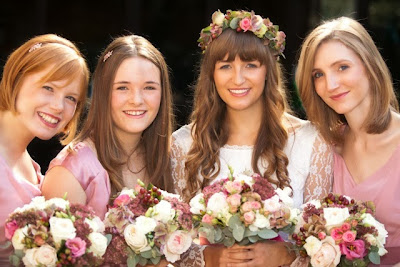 Real vintage bride Olivia in 1960s lace vintage wedding dress, with three bridesmaids