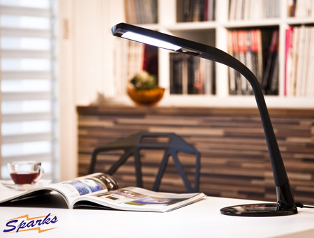 A Wing 1W LED table light in action, black finish