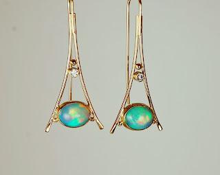18k triangular shaped earrings with Ethiopian opals.