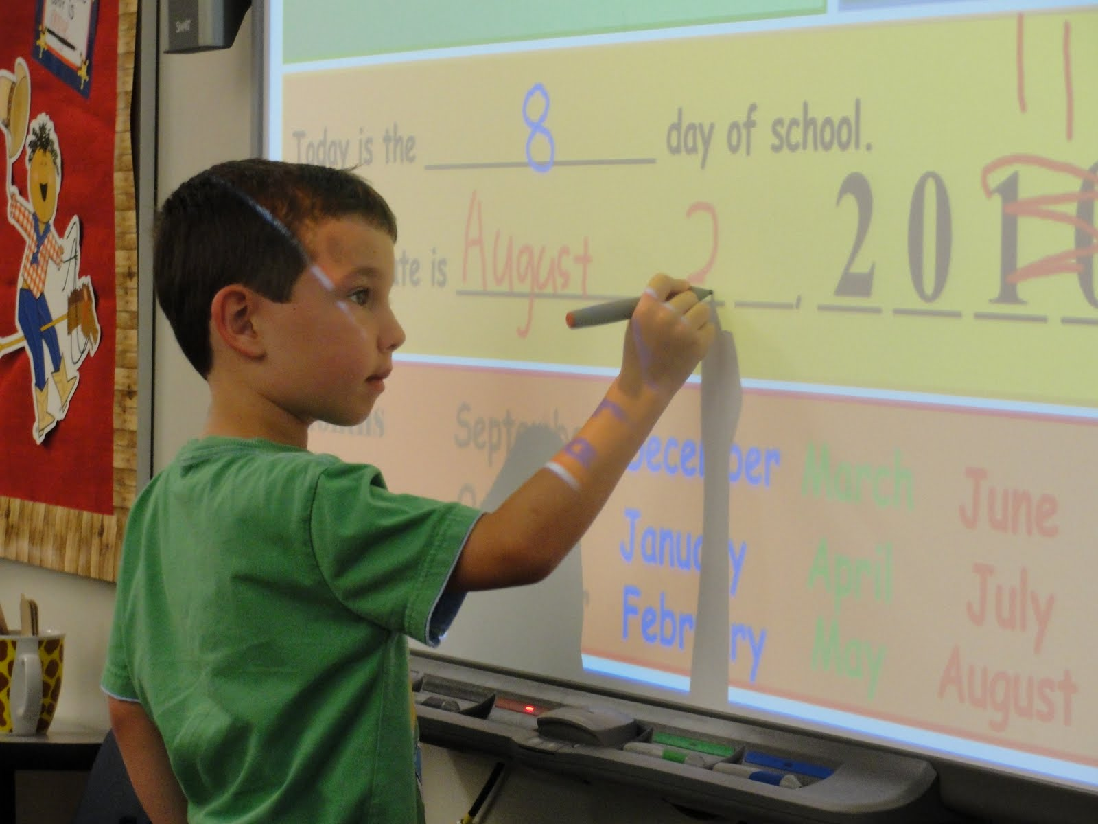 Lawson's turn at the Smart Board arrived when his name stick was ...