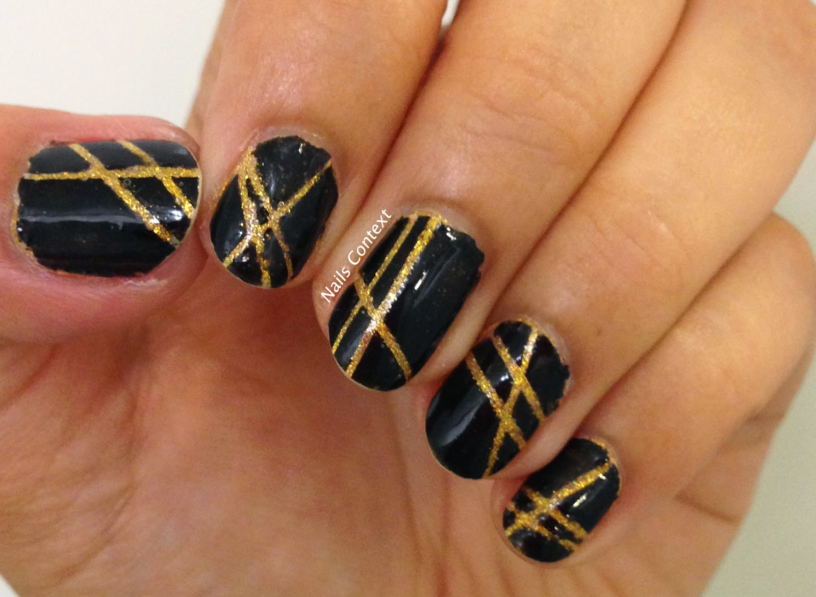 Nails Context: Black n Gold laser tape manicure