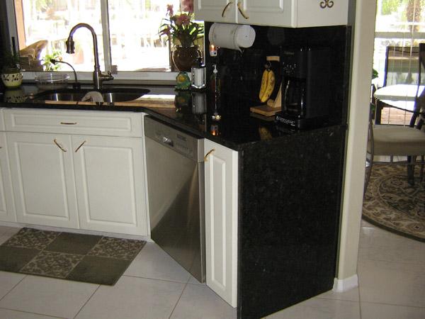 Encimeras de granito y muebles de madera para la for Muebles para encimeras
