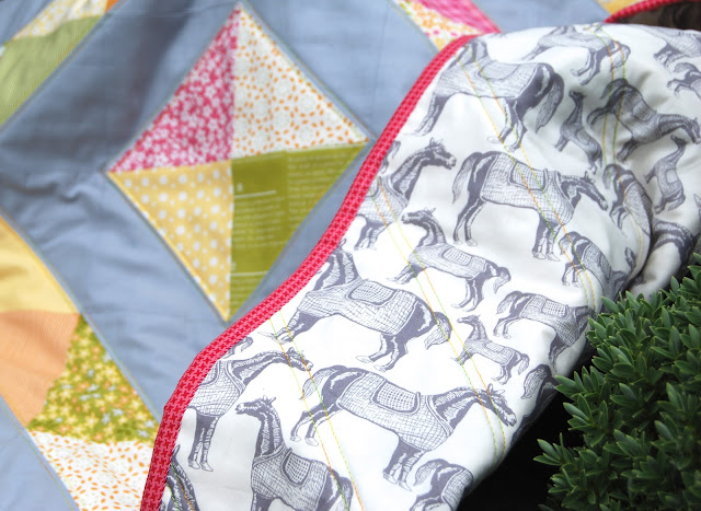 Baby quilt with half square triangles