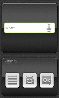 """Tela de fundo preto. No meio da tela um espaço de edição escrito """"what?"""" e um microfone ao lado. Abaixo, três botões cinza: uma lista,  o logo do android e um OK."""