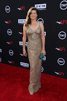 Daphne Zuniga in a shiny gown on the red carpet