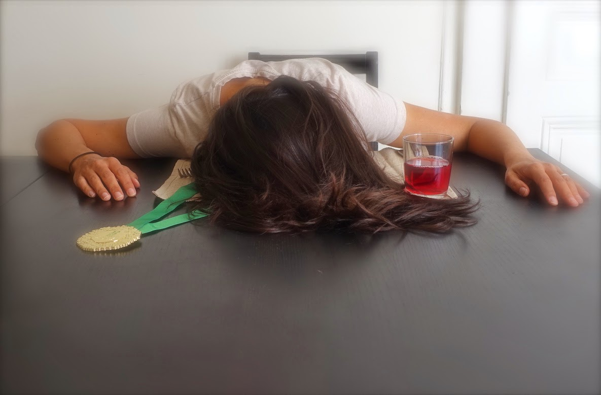 Picture of girl lying face down on her plate