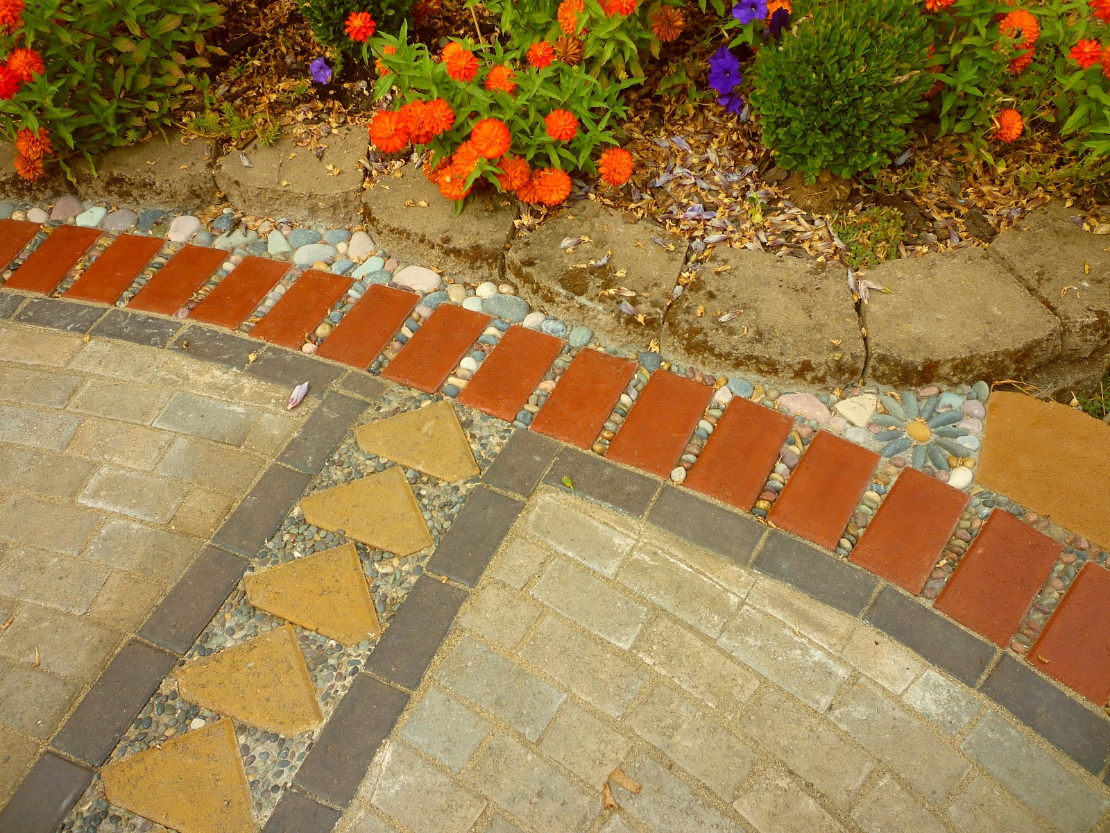 Creating A Paver And Pebble Mosaic Patio