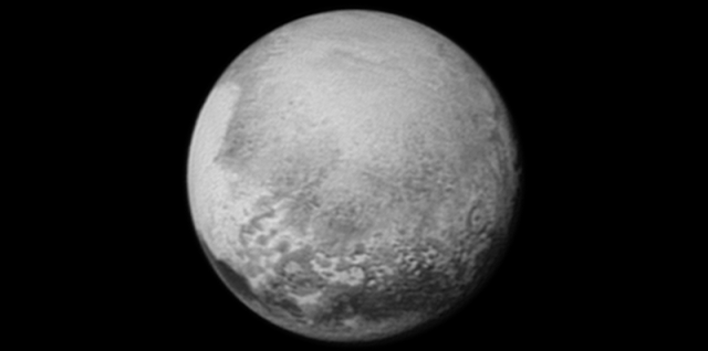 "Pluto's bright, mysterious ""heart"" is rotating into view, ready for its close-up on close approach, in this image taken by New Horizons on July 12 from a distance of 1.6 million miles (2.5 million kilometers). It is the target of the highest-resolution images that will be taken during the spacecraft's closest approach to Pluto on July 14. The intriguing ""bulls-eye"" feature at right is rotating out of view, and will not be seen in greater detail. Credits: NASA/JHUAPL/SWRI"