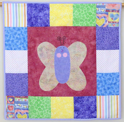 wall hanging with applique butterfly