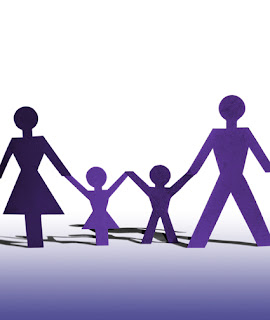 image of family of two parents and two children holding hands.