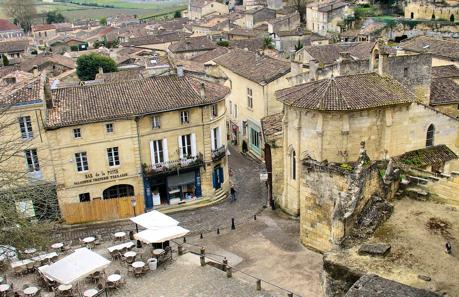 View of Saint-Emilion as seen from the square outside the Monolithic Church square. Chapel of the Holy Trinity can be seen to the right.