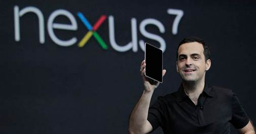 Hugo Barra, Director of Google Product Management, holds up the new Google Nexus7 tablet at the Google I/O conference in San Francisco